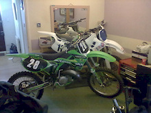 my yz and my kx in the living room testing the boundries. what will she say i wonder when she gets in from work